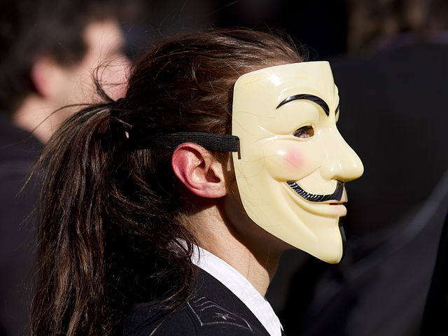 Girl wearing Anonymous mask